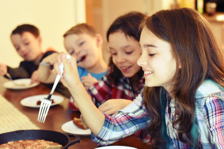 kids eating apple cider cake