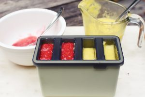 filling popsicle molds