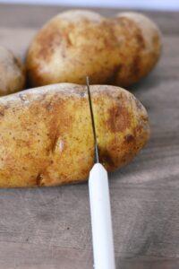 making Hasselback potatoes